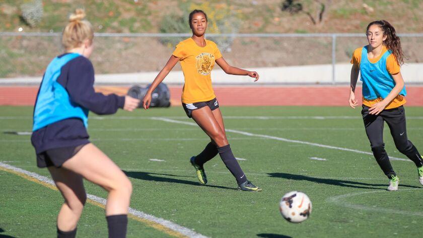 SAN DIEGO, CA February 20th 2018 | El Camino High School girls soccer player Jada Wilson (middle) pr
