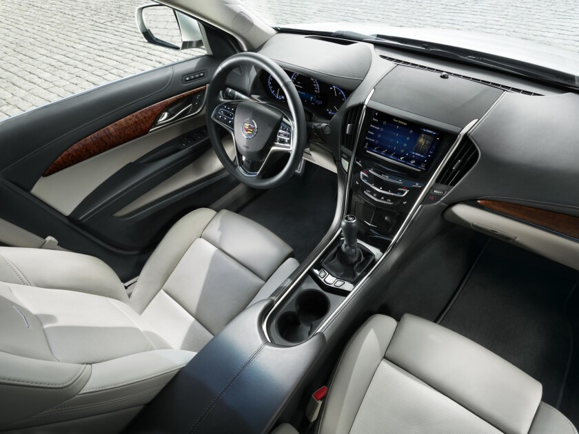 The Cadillac ATS interior is seen. In its CPO programs, Cadillac extends its new car warranty to 72 months or 70,000 miles from the original in-service date.