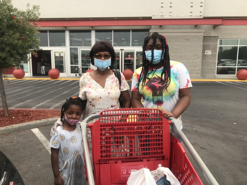 Lessie Tanson took her 11- and 4-year-old granddaughters back to school shopping at Target in Stockton.