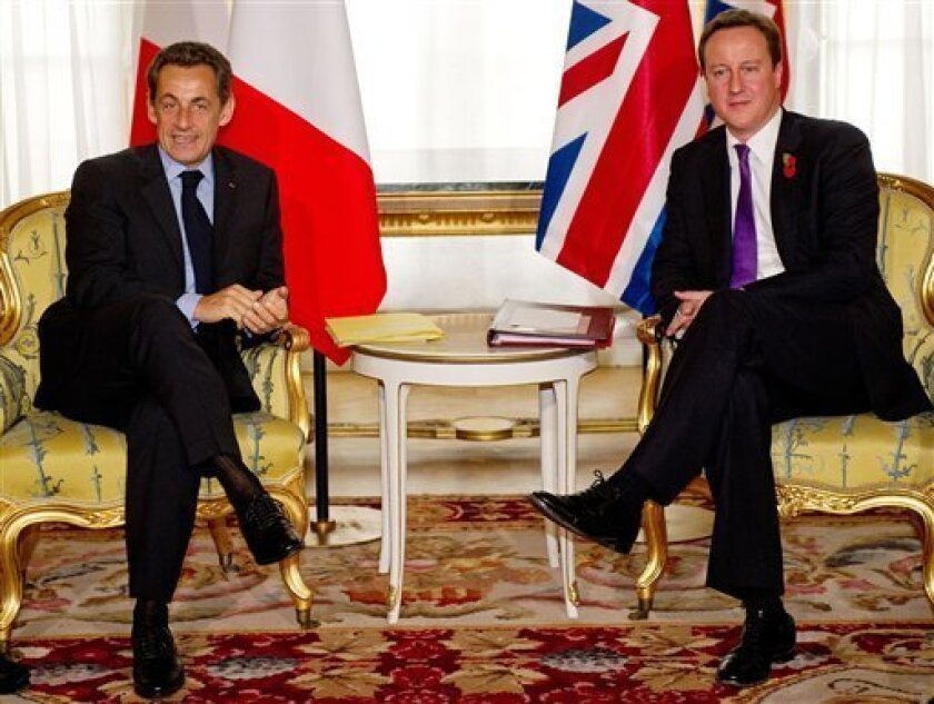 French President Nicolas Sarkozy, and Britain's Prime Minister David Cameron pose for photographers ahead of an Anglo-French summit at Lancaster House in London, Tuesday Nov. 2, 2010. Britain and France signed defence treaties at the summit, setting out cooperation on issues including military planes and aircraft carriers.(AP Photo/Leon Neal, pool)