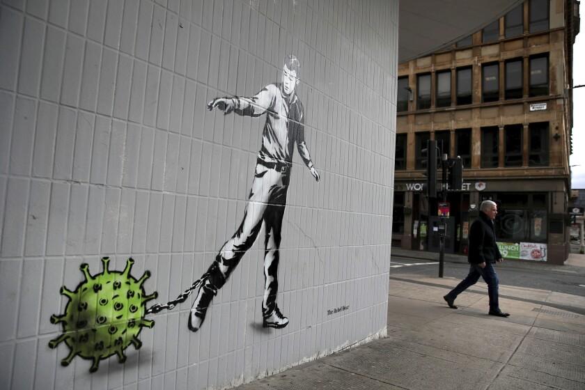 Coronavirus-themed art on a wall in Scotland