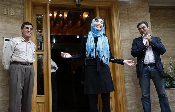 American Iranian journalist Roxana Saberi, flanked by her father, Reza, left, and an unidentified family member, talks to the media after her release from prison in Tehran. Saberi was convicted of spying last month and sentenced to eight years in prison. An appeals court freed her Monday.