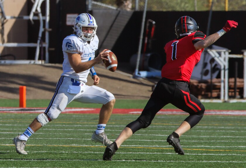 La Jolla Country Day quarterback E.J. Kreutzmann (shown in an earlier game) led the Torreys' offensive charge.
