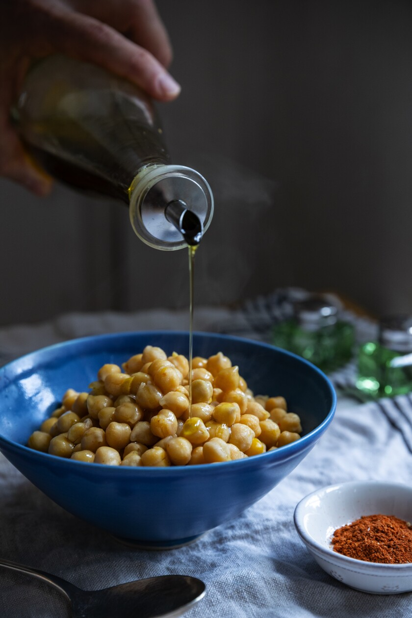 Chickpeas drizzled with olive oil.