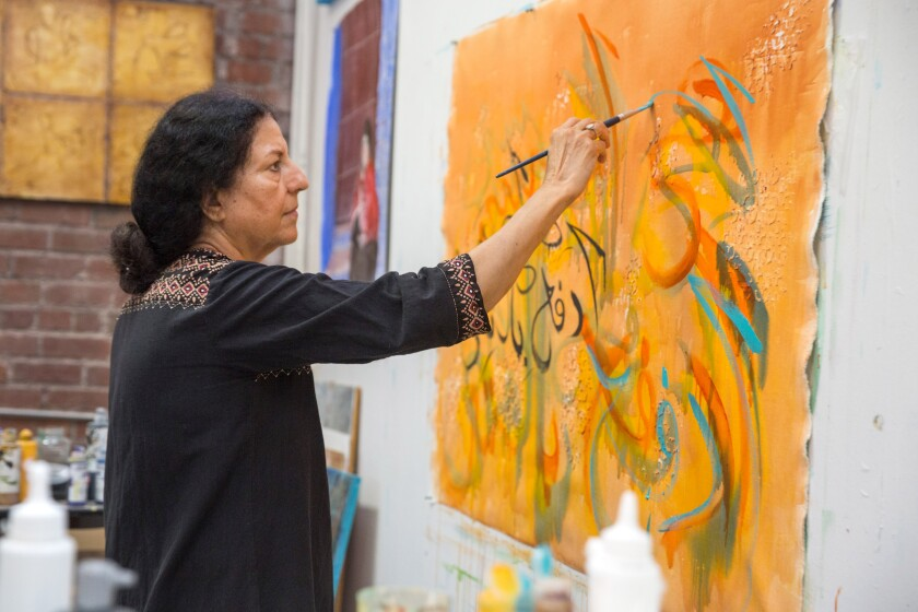 Salma Arastu, who incorporates Islamic calligraphy in her painting, photographed in her Berkeley studio.