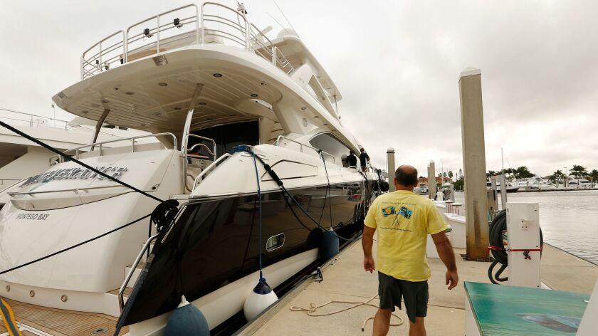 At the Naples Boat Club, million-dollar boats are at risk of being hit by Hurricane Irma. Bill Charb