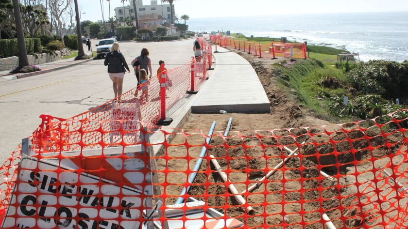 Day 3: As the Whale View Point sidewalk concrete settles, tourists use the adjacent roadway as an al