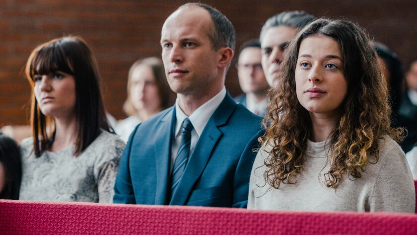 "Sarah Booth, left, Ian Lake and Addison Holley in the 2019 movie ""Trapped: The Alex Cooper Story"" on Lifetime."