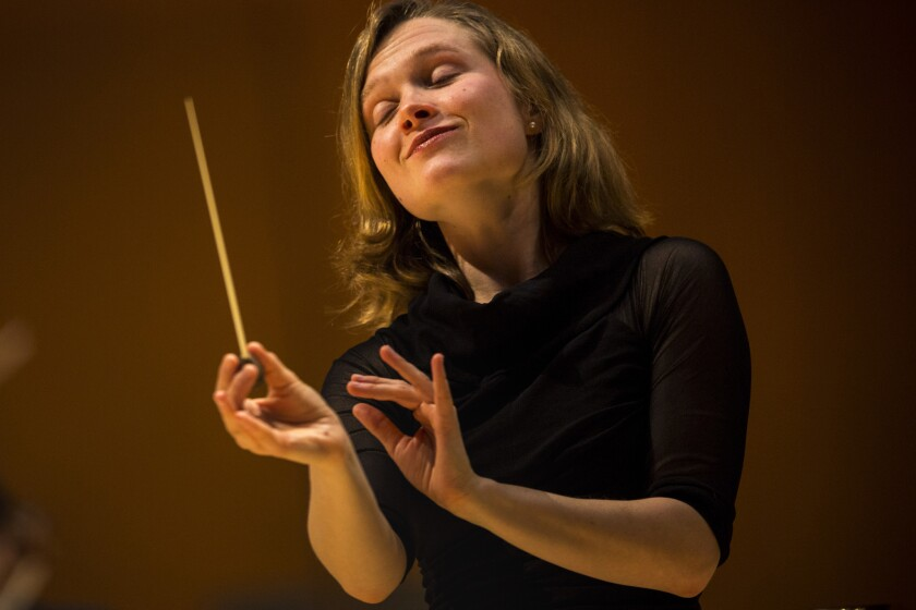 Mirga Grazinyte-Tyla impresses again with Los Angeles Philharmonic, conducting three varied works at Disney Hall.