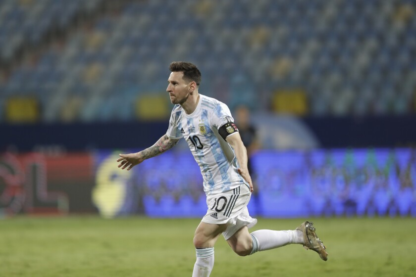 Argentina's Lionel Messi celebrates scoring his side's third goal against Ecuador during a Copa America quarterfinal soccer match at the Olimpico stadium in Goiania, Brazil, Saturday, July 3, 2021. (AP Photo/Andre Penner)
