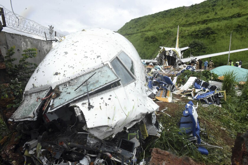 The wreckage of the Air India Express flight that skidded off a runway while landing in Kozhikode, India.