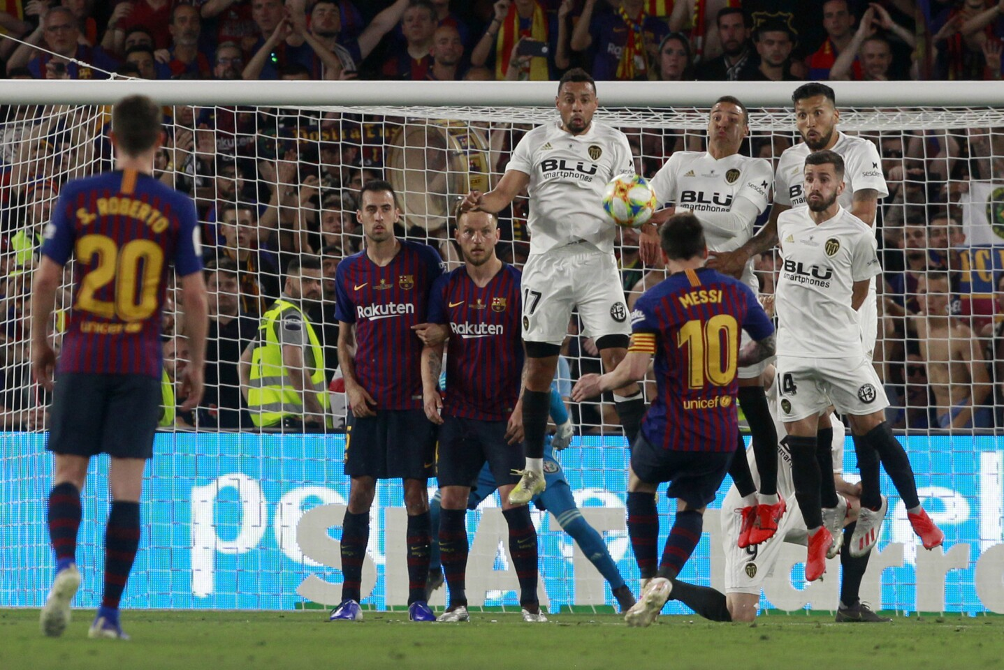 Barcelona forward Lionel Messi takes a free kick during the Copa del Rey soccer match final between Valencia CF and FC Barcelona at the Benito Villamarin stadium in Seville, Spain, Saturday. 25, 2019.