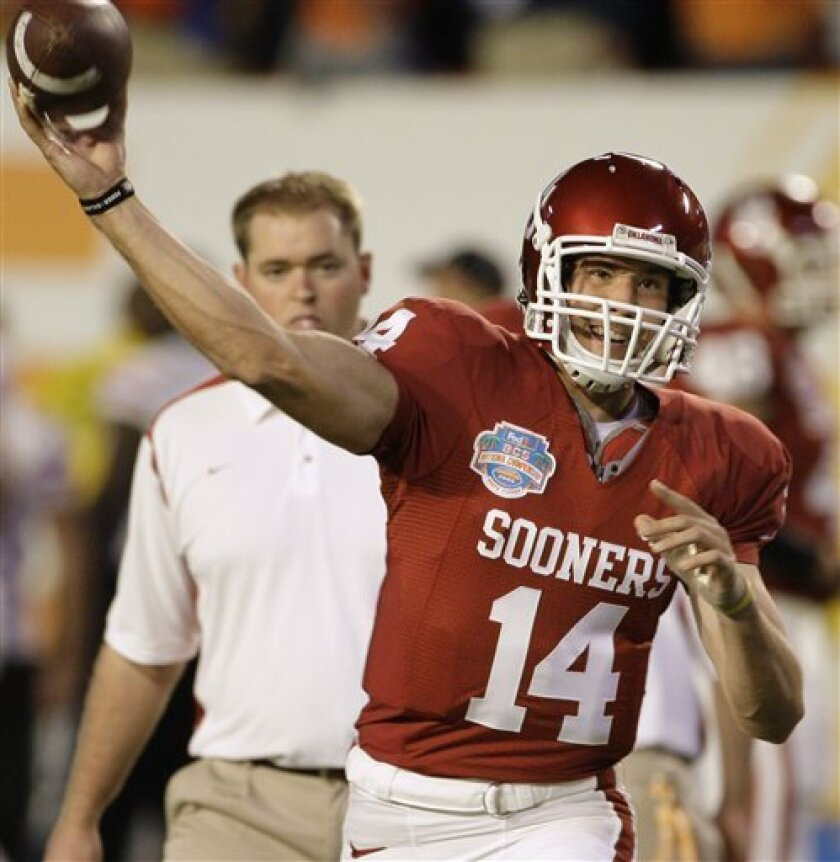 Oklahoma quarterback Sam Bradford loosens up before the BCS Championship NCAA college football game against Florida on Thursday, Jan. 8, 2009, in Miami. (AP Photo/Mark Humphrey)