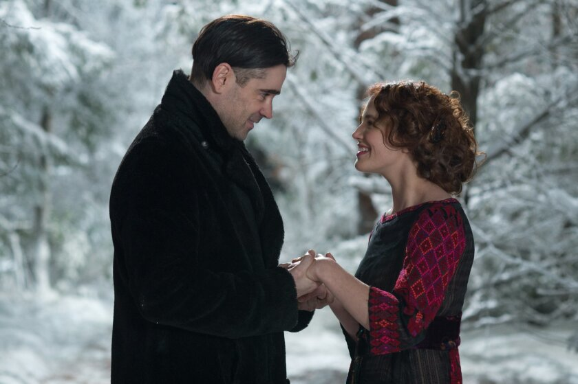 """This image released by Warner Bros. shows Jessica Brown Findlay, right, and Colin Farrell in a scene from """"Winter's Tale."""" (AP Photo/Warner Bros., David C. Lee)"""