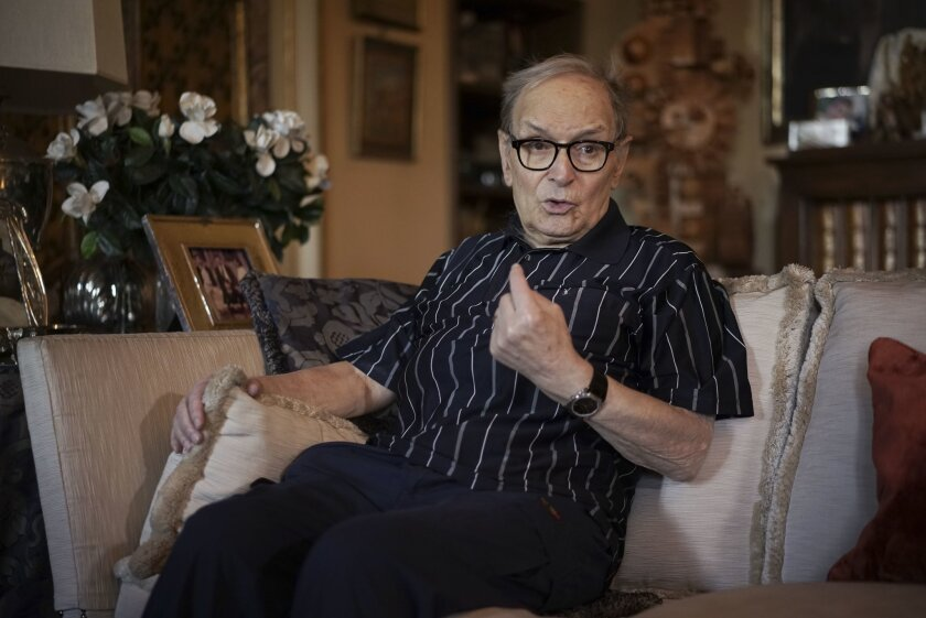 Three-time best sound-track Oscar winner Ennio Morricone answers questions during an interview with The Associated Press, in Rome, Tuesday, May 31, 2016. Oscar-winning composer is back on his feet after canceling a string of concerts because of a collapsed vertebrae that raised questions about the