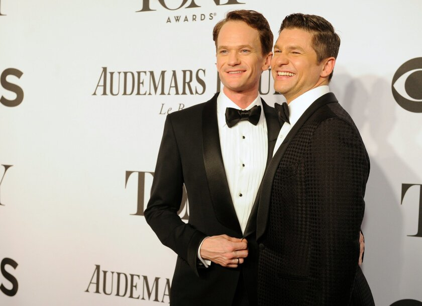 """FILE - In this June 8, 2014 file photo, Neil Patrick Harris, left, and David Burtka arrive at the 68th annual Tony Awards at Radio City Music Hall in New York. The """"How I Met Your Mother"""" star and his actor-chef groom were married Sept. 6, in Italy. They'd been dating for 10 years and are parents to 3-year-old twins, Gideon and Harper. (Photo by Charles Sykes/Invision/AP, File)"""