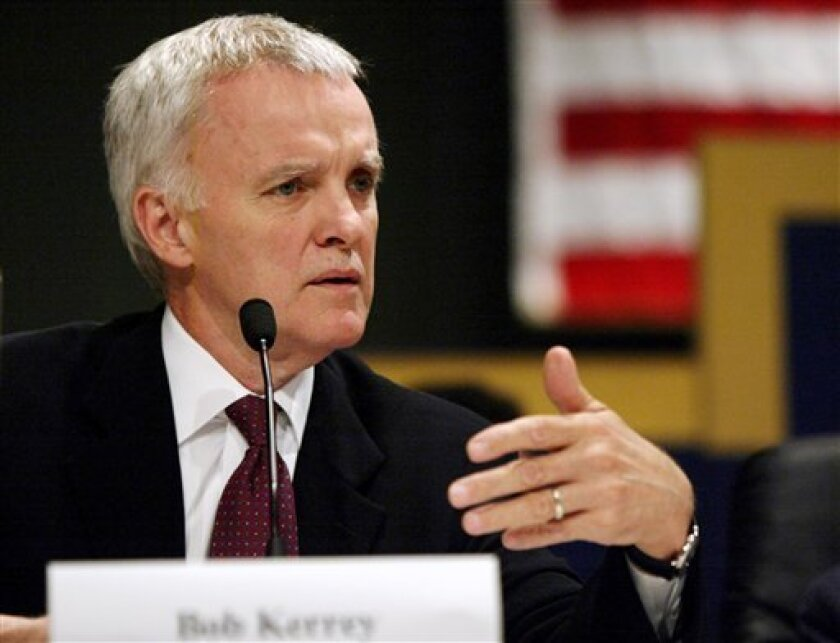 FILE - In this June 16, 2004 file photo, former Nebraska Sen. Bob Kerrey speaks in Washington. More than a decade after he left Nebraska for New York City, Kerrey is considering an improbable comeback run for his old Senate seat. (AP Photo/Evan Vucci, File)