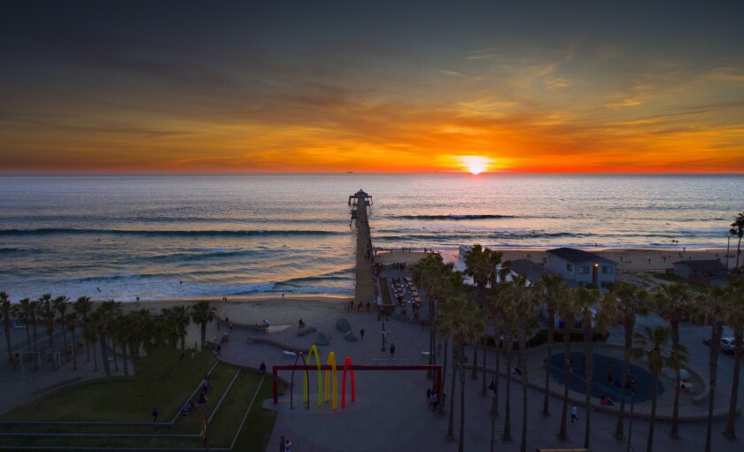 View from high above of Imperial Beach Pier during sunset.