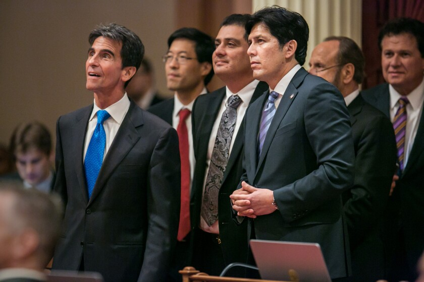 Senate leader Kevin de León (D-Los Angeles), with folded hands, watches as votes are cast on SB 350, a bill to fight climate change. The legislation was signed by Gov. Jerry Brown on Wednesday in Los Angeles.