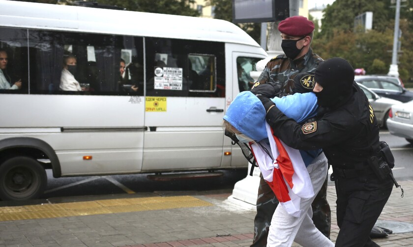 Police detain a student protester in Minsk, Belarus, on Tuesday.