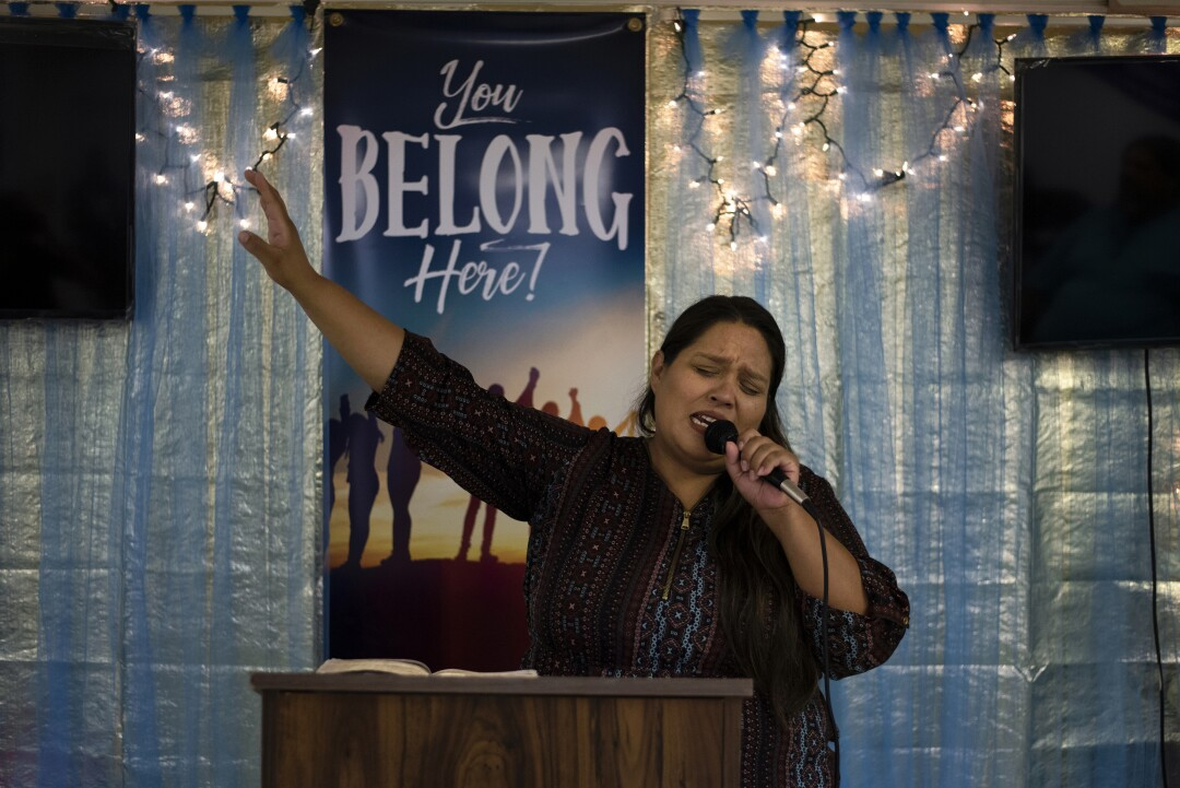 Silva preaches to the congregation at the small community church she leads.