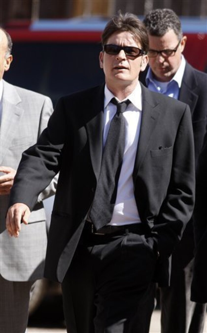 FILE -- In a March 15, 2010 file photo, Charlie Sheen enters Pitkin County Courthouse in Aspen, Colo. to attend a hearing on domestic violence charges. Sheen is expected to appear in an Aspen Colorado court Monday June 7, 2010 for a hearing related to domestic violence allegations. (AP Photo/David Zalubowski/file)