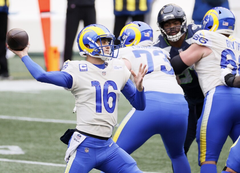 Jared Goff of the Rams looks to pass against the Seahawks during the first quarter of Saturday's game in Seattle.