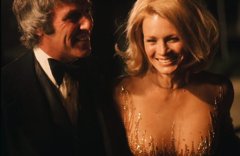 Burt Bacharach and Angie Dickinson arrive at the Oscars in 1976.
