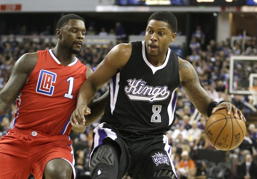 Kings forward Rudy Gay, right, drives against Clippers guard Lance Stephenson during the teams' 2015 season opener on Oct. 28 in Sacramento.