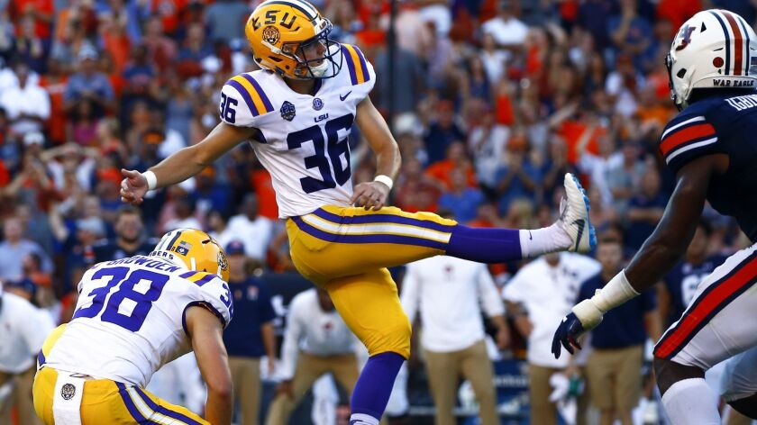 LSU place kicker Cole Tracy (36) kicks the winning field goal to defeat Auburn 22-21 during the seco