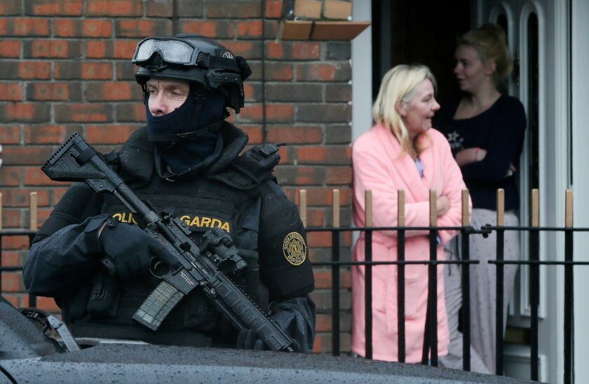 Armed Gardai from the force's Emergency Response Unit on patrol, as gang violence has resulted in two murders in four days, in Dublin, Ireland, Tuesday, Feb. 9, 2016. As Dublin's gangland tensions deepened, Ireland's justice minister urged gang members to seek police protection Tuesday after gunmen
