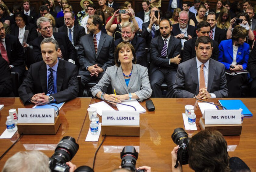 Douglas Shulman, former commissioner of the Internal Revenue Service, left, Lois Lerner, the director of the IRS's exempt organizations office, center, and Neal Wolin, deputy secretary of the U.S. Treasury, right, wait to testify at a House Oversight and Government Reform Committee hearing in Washington, D.C.