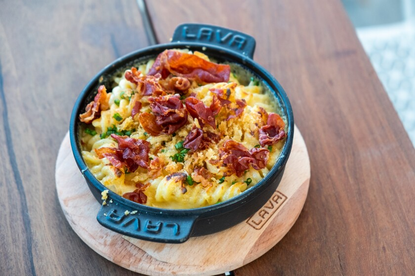 The mac 'n cheese with crispy prosciutto at Gravity Heights is a decadent treat.