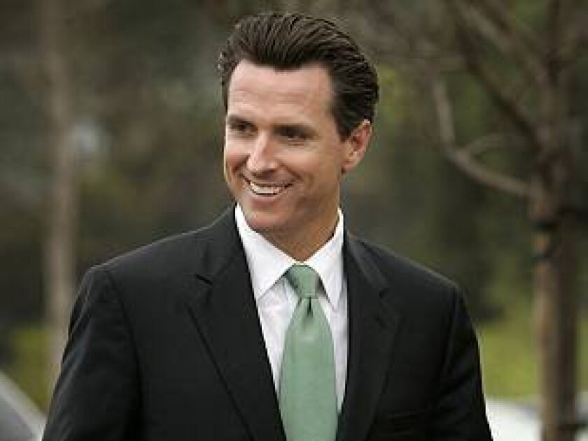 San Francisco Mayor Gavin Newsom wore a green tie Wednesday when he visited San Diego, touting his green credentials.
