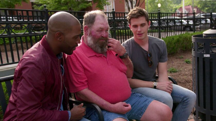 """""""Queer Eye"""" makeover participant Tom Jackson, center, with co-hosts Karamo Brown, left, and Antoni Porowski. """"When I first saw him, I was like, 'This is gonna be rough.' But ... he was really receptive,"""" says Bobby Berk."""