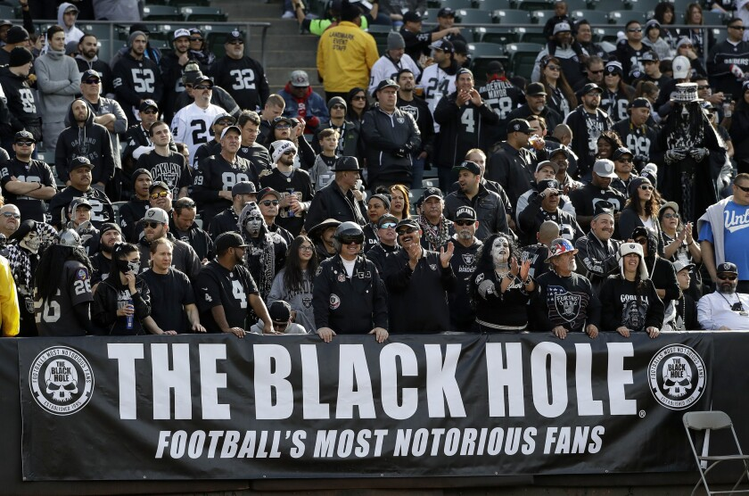 Raiders fans at a game between Oakland and the visiting Carolina Panthers on Nov. 27.