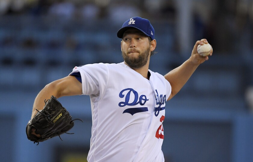 Los Angeles Dodgers starting pitcher Clayton Kershaw throws during the first inning of the team's baseball game against the St. Louis Cardinals on Tuesday, Aug. 6, 2019, in Los Angeles. (AP Photo/Mark J. Terrill)