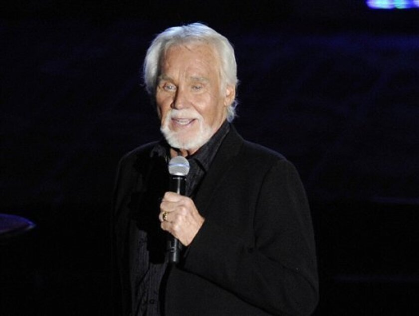 FILE - This June 14, 2012 file photo shows singer Kenny Rogers performing at the 2012 Songwriters Hall of Fame induction and awards gala at the Marriott Marquis Hotel in New York. The northeast Georgia home owned by country singer Kenny Rogers that was scheduled to be put up for auction has been so