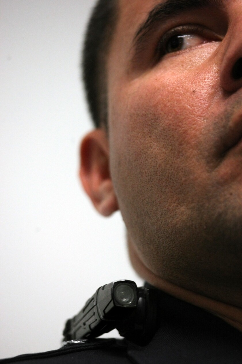 A Los Angeles police officer wears a Taser Axon clip-on camera on his collar at a press conference Wednesday. Police officials announced 30 volunteer officers had begun testing the cameras as part of a pilot program.