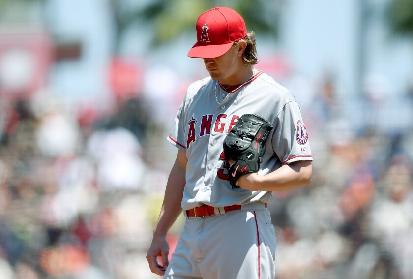 Angels pitcher Jered Weaver reacts after giving up a home run to Giants second baseman Joe Panik in the first inning of Sunday's game at AT&T Park.