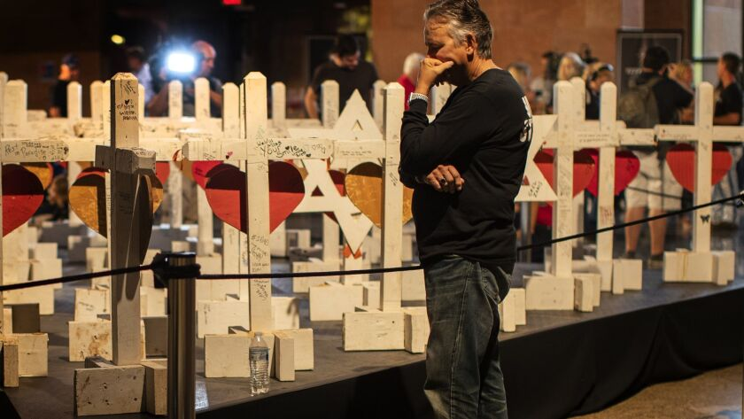 LAS VEGAS, NV - OCTOBER 1, 2018: Chris Davis spends time alone at a cross made for his daughter Neys
