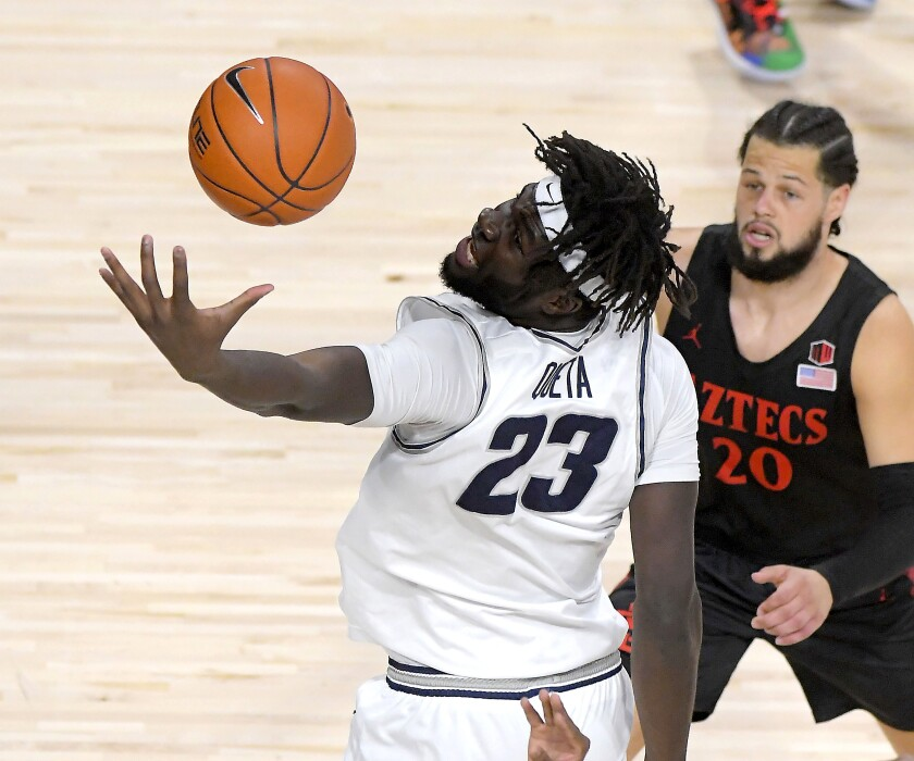 Utah State center Neemias Queta (23) reaches out for a rebound as San Diego State guard Jordan Schakel (20) defends during the first half of an NCAA college basketball game Saturday, Jan. 16, 2021, in Logan, Utah. (Eli Lucero/The Herald Journal via AP, Pool)