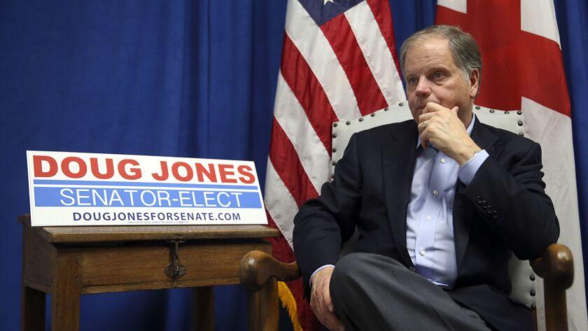 Democrat Sen.-elect Doug Jones speaks during an interview with The Associated Press Wednesday, Dec.