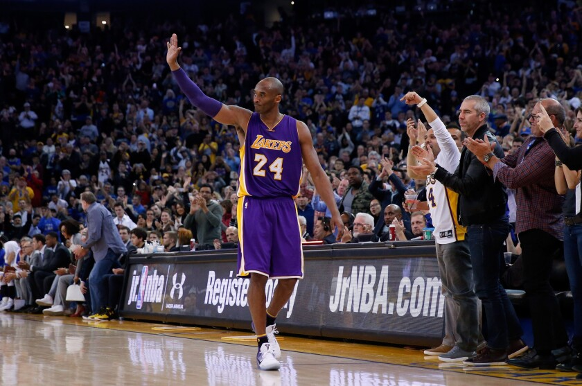 Lakers' Kobe Bryant waves to the crowd in Oakland after being taken out in the fourth quarter against the Golden State Warriors on Thursday.