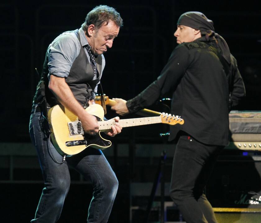 """Bruce Springsteen performs with longtime E Street Band mate Stevie Van Zandt during a 2012 tour stop in Anaheim. Springsteen and the band have recorded a new studio version of the Suicide song """"Dream Baby Dream"""" and posted a new video to mark the end of the Wrecking Ball tour."""