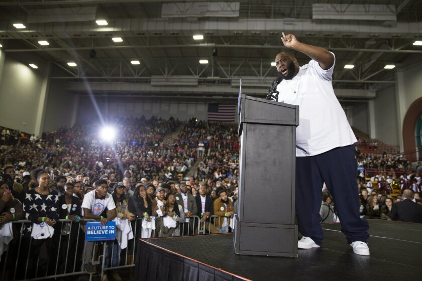 Hip Hop artist and activist Killer Mike speaks during a rally with Democratic presidential candidate Sen. Bernie Sanders, I-Vt., at Morehouse College, on Tuesday, Feb. 16, 2016, in Atlanta. (AP Photo/Evan Vucci)
