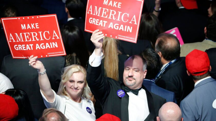 People in the crowd at Donald Trump's election night event watch results continue to come in at the New York Hilton early in the morning of Nov. 8.
