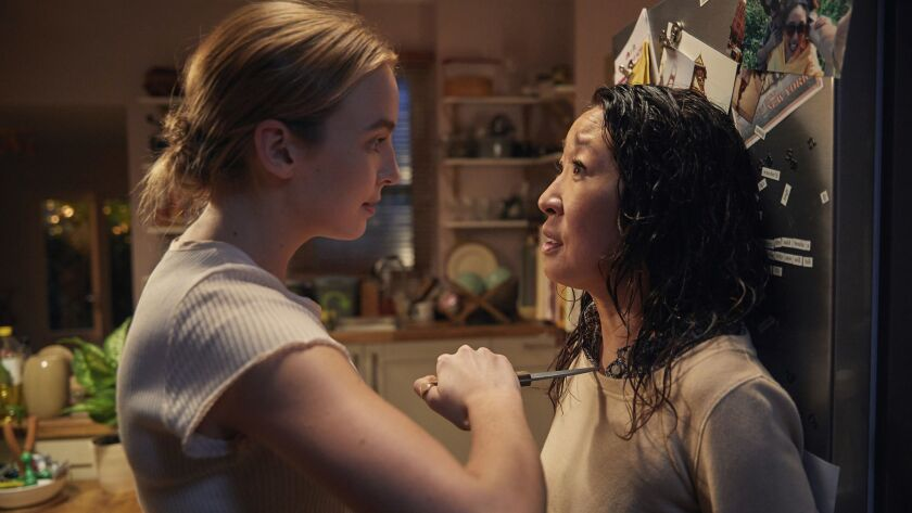 "Villanelle (Jodie Comer) and Eve (Sandra Oh) in the BBC America show ""Killing Eve."" Season: 1"