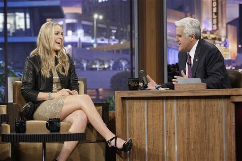 """In this image released by NBC, Olympic Gold Medalist skier Lindsey Vonn, left, is shown during an interview with host Jay Leno on """"The Tonight Show with Jay Leno,"""" Monday, March 1, 2010, in Burbank, Calif. (AP Photo/NBC, Paul Drinkwater)"""