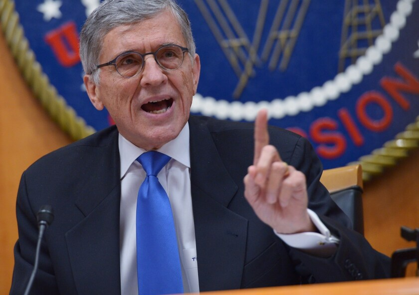 Federal Communications Commission Chairman Tom Wheeler speaks during an FCC meeting Feb. 26 in Washington. The commission adopted a new set of net neutrality rules that day, but the text of the order was not released until Thursday.